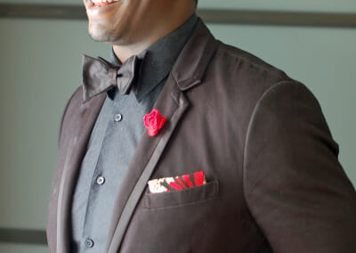 brown-suit-red-accent